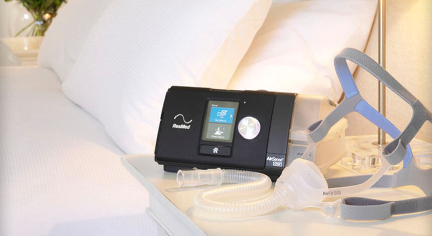 CPAP machine and mask close to bed