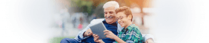 grandfather-and-grandson-using-tablet-in-the-park-picture-ResMed
